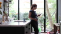 Pregnant woman checking smartphone at home 42058512