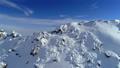 Aerial shot of snowy mountain peak. 42099384
