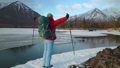Tourist stands near the lake in mountais 42099393