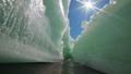sunlit melting ice crack in the spring 42099402