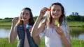 sincere emotions of teen girls with soap bubbles in open air 42127117