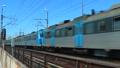 Passing commuter train 42145432