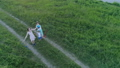 dreams of travel, happy family with globe in hands raised up on meadow in drone view 42169291