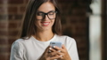 Smiling Woman Uses Smartphone 42291679
