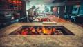 Burning firewood in restaurant kitchen interior 42301970