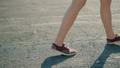 girl walks. focus on her feet in red sneakers 42303685