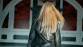 fashion portrait of a beautiful young woman with blue eyes and blonde hair in a leather jacket 42303961