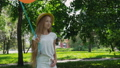 Portrait of pretty girl poses at camera with colourful balloons in sunny park 42408960