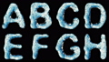 Alphabet from water isolated on a black background. 42476733