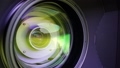 View of the glass elements in a camera lens. Objective under yellow light. Tilt-shift use. 42569203