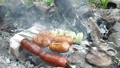 Sausages and onion skewering in private garden 42625900
