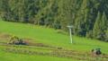 Farmers work in the fields in South Tyrol 42650442