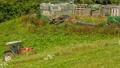 Farmers work in the fields in South Tyrol 42650443