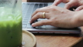 Woman typing on laptop and drinking iced green tea 42661550