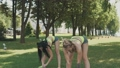Sport fitness. Gymnastics girls make warming up stretching outdoor in park 42725077