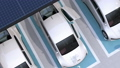 White electric car departing from car sharing private parking lot 42787908