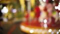 Blur kid playing on Carousel and bokeh of light at night. 42895605
