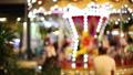 Blur kid playing on Carousel and bokeh of light at night. 42904631