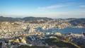 Nagasaki city skyline in Nagasaki, Japan timelapse 42991809