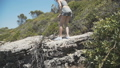 Young girl climb on ruined stone wall and looking at the sea 43012263