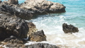 Wave splasing about stones on mediterranean sea. FullHD 43012269