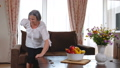 Senior woman suffering from backache at home 43258235