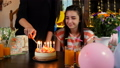 Happy teen girl with birthday cake at party 43291471