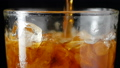 Slow motion pouring cola soda rootbeer mixed water 43311269