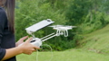 Young woman controlling drone with a transmitter  43365899