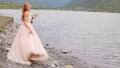 Beautiful bride against the background of mountains and river. Wedding day 43644099