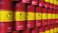 Group of rows of red stacked oil drums in storage  43672804
