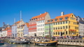 People are traveling at Nyhavn in Copenhagen 43711714