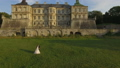 Aerial view of wedding couple dancing at ancient castle 43767735