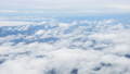 Aerial view of clouds hrough airplane window 43787642