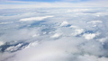 Aerial view of clouds hrough airplane window 43787644