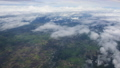 Aerial view of clouds through airplane window 43787645