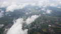 Aerial view of clouds through airplane window 43787647