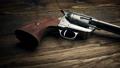 Passing Six Shooter Gun On Table 43846663