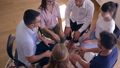 young people on group therapy session take each others hands sitting in circle 43874594