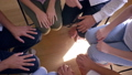 symbol of support, many hands make circle of fists on group psychotherapy in slow motion 43874624