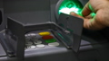 ATM close-up and the user's hand with a plastic card 43919838