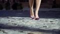 Beautiful female legs on a city street 43993575