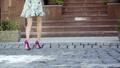 Beautiful female legs on a city street 43993576
