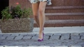 Beautiful female legs on a city street 43993577