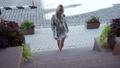 Beautiful girl walking the city street 43993592