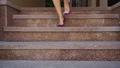 Beautiful female legs on a city street 43993594