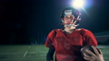 A man walks, holding a ball for American football in hands. FullHD. 44074941