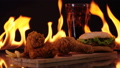 Hamburger and chicken fast food on fire  44147542