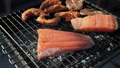 Salmon stake frying outside 44166756