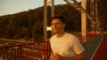 man jogging along the bridge 44248552